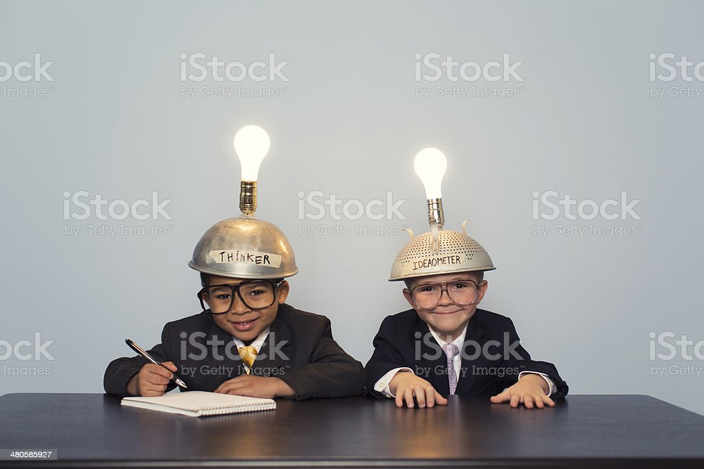 Two Business Boys Wearing Lit Up Thinking Caps stock photo