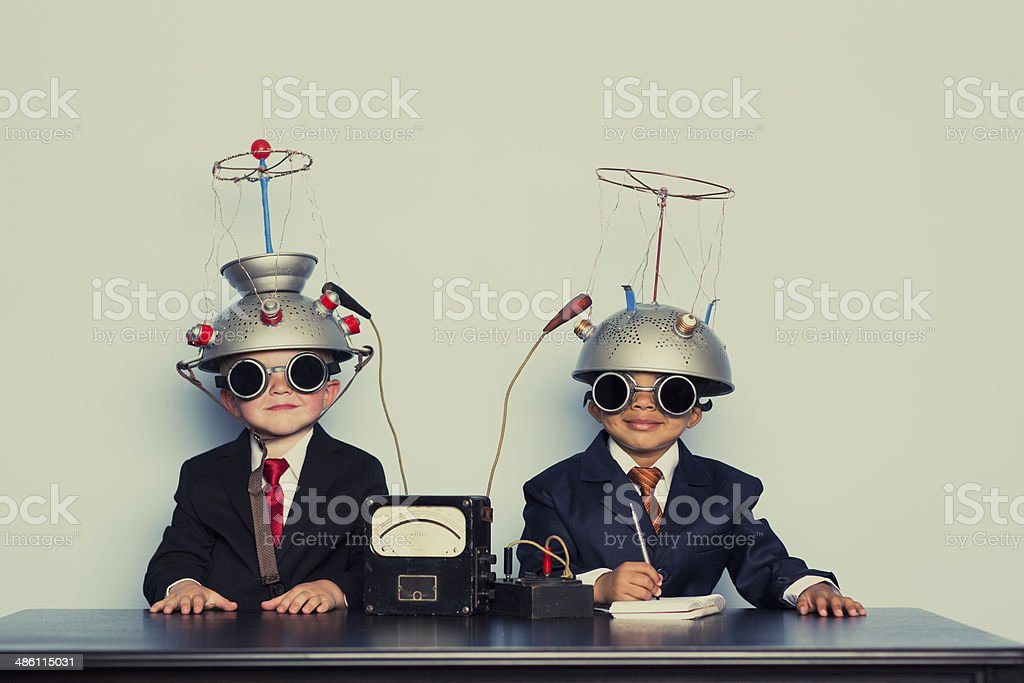 Two Business Boys with Mind Reading Helmets stock photo