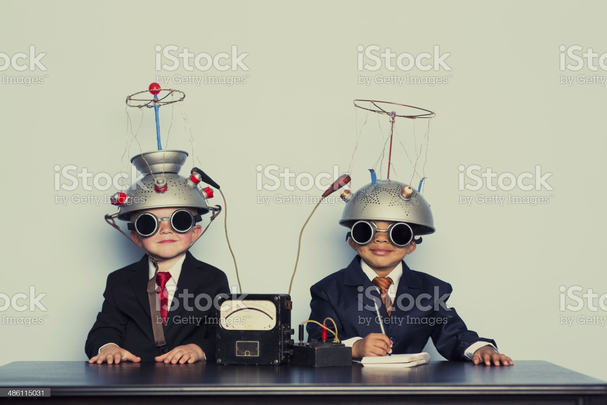 Two Business Boys with Mind Reading Helmets royalty-free stock photo