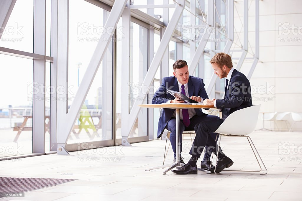 Two business colleagues at meeting in modern office interior stock photo