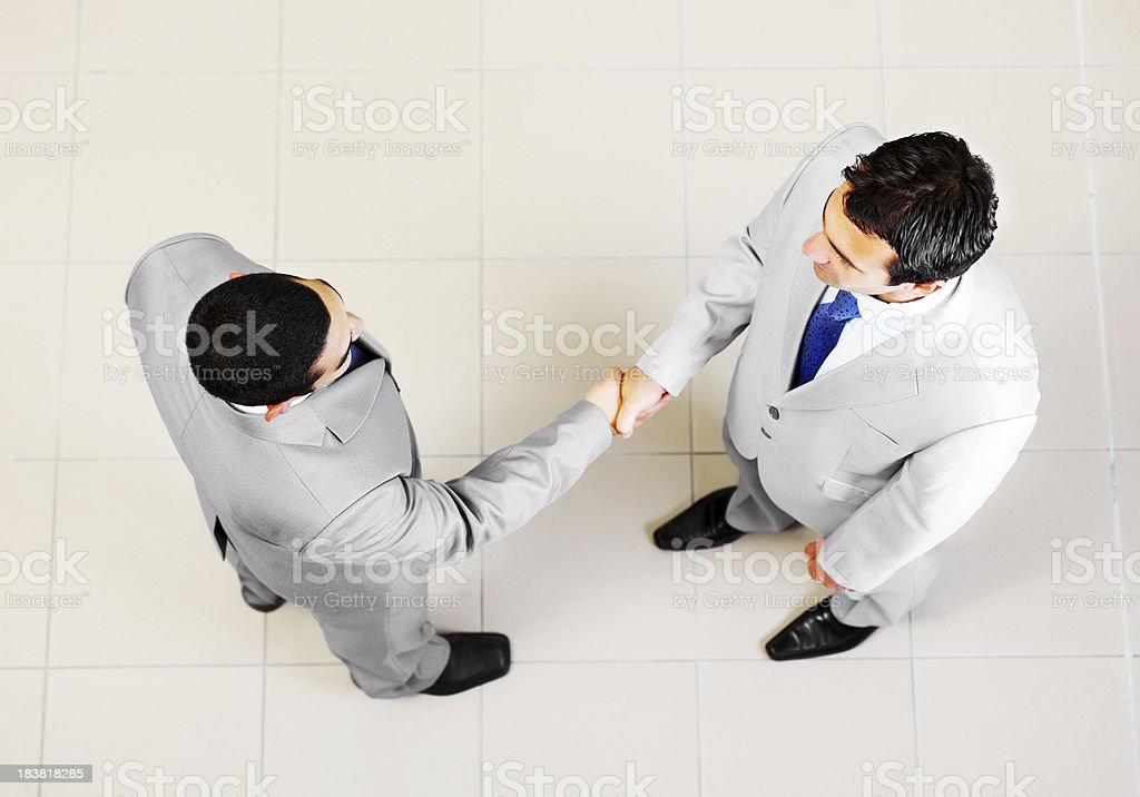Two business colleagues handshaking royalty-free stock photo