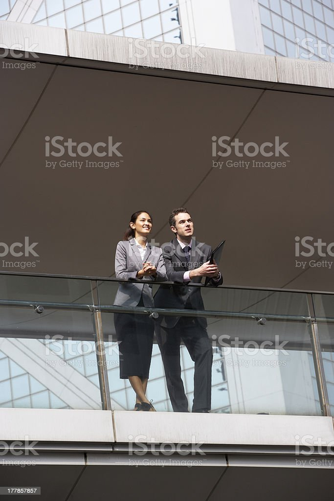 Two Business Colleagues Having Discussion Outside Office Buildin royalty-free stock photo