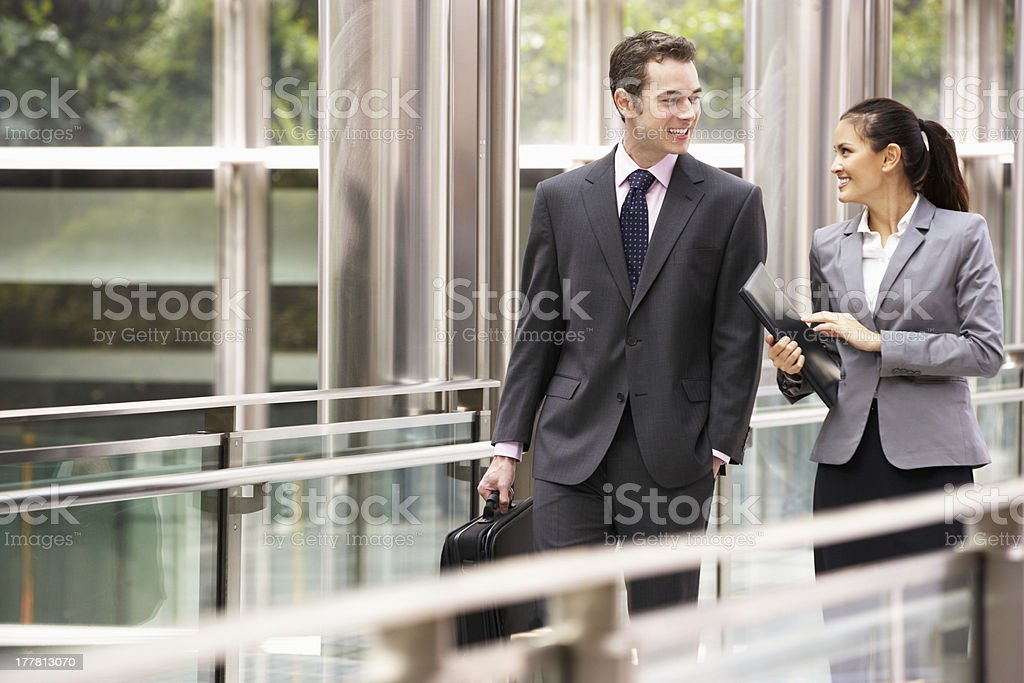 Two Business Colleagues Having Discussion Whilst Walking Outside stock photo