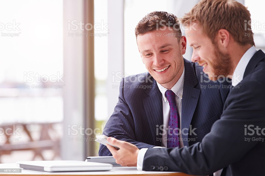 Two business colleagues in a meeting, close up stock photo