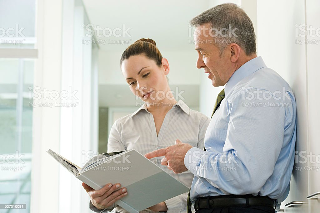 Two business colleagues reading a document stock photo
