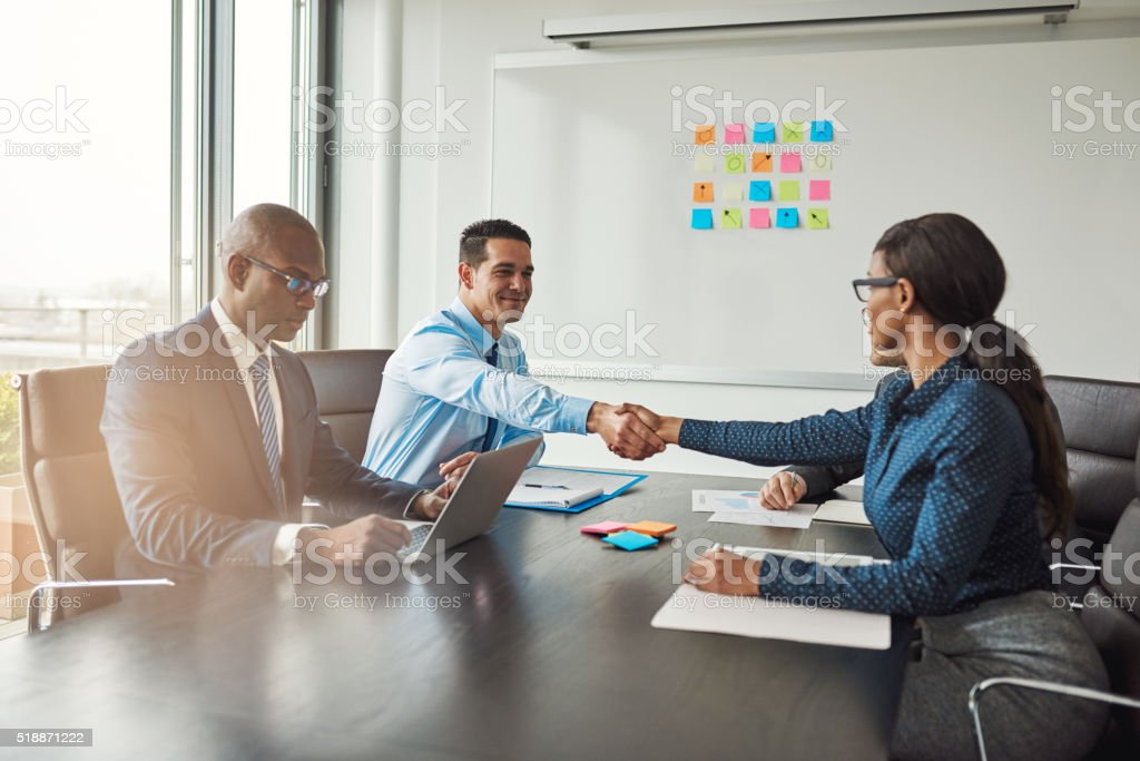 Two business colleagues shaking hands stock photo