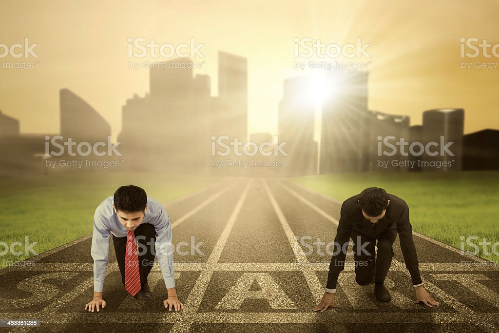 Two business competitor ready to start stock photo