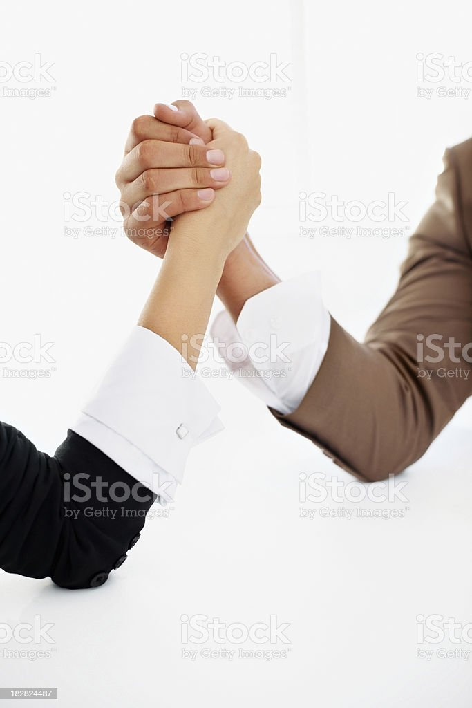 Two business competitors arms wrestling against white royalty-free stock photo