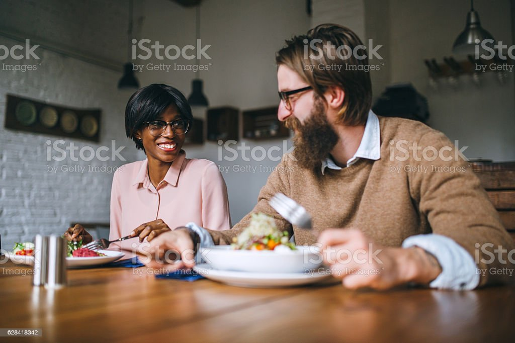 Two business friends eating salad at restaurant stock photo