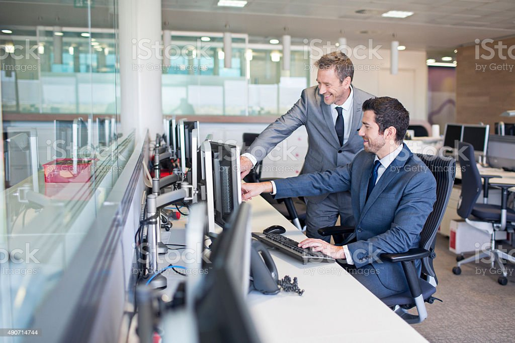 Two business man working in the office stock photo