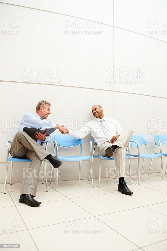 Two business men greeting eachother royalty-free stock photo