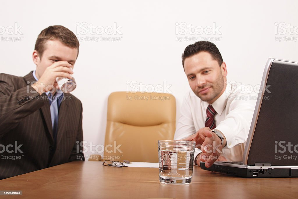 two business men having braje for drinking water royalty-free stock photo