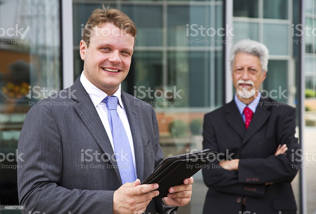 Two business men with a tablet royalty-free stock photo