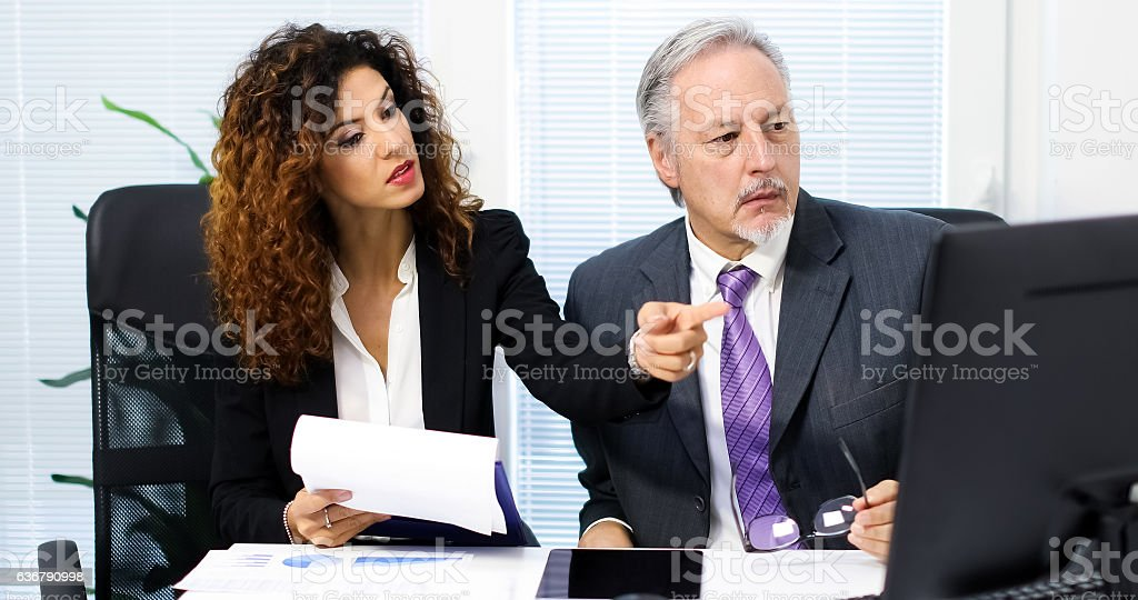Two business partners discussing plans or ideas at meeting stock photo