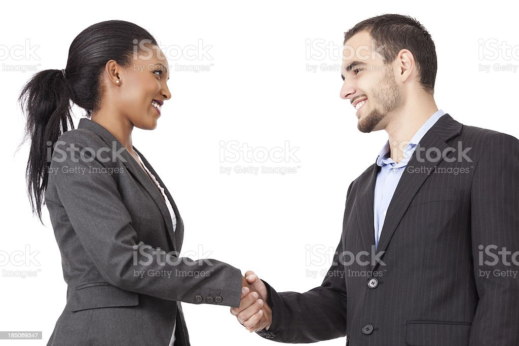 Two business partners handshaking after closing a deal stock photo