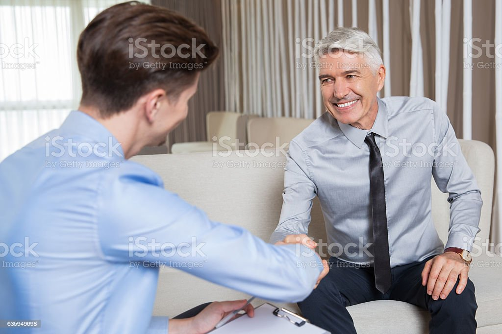 Two Business Partners Shaking Hands After Meeting stock photo