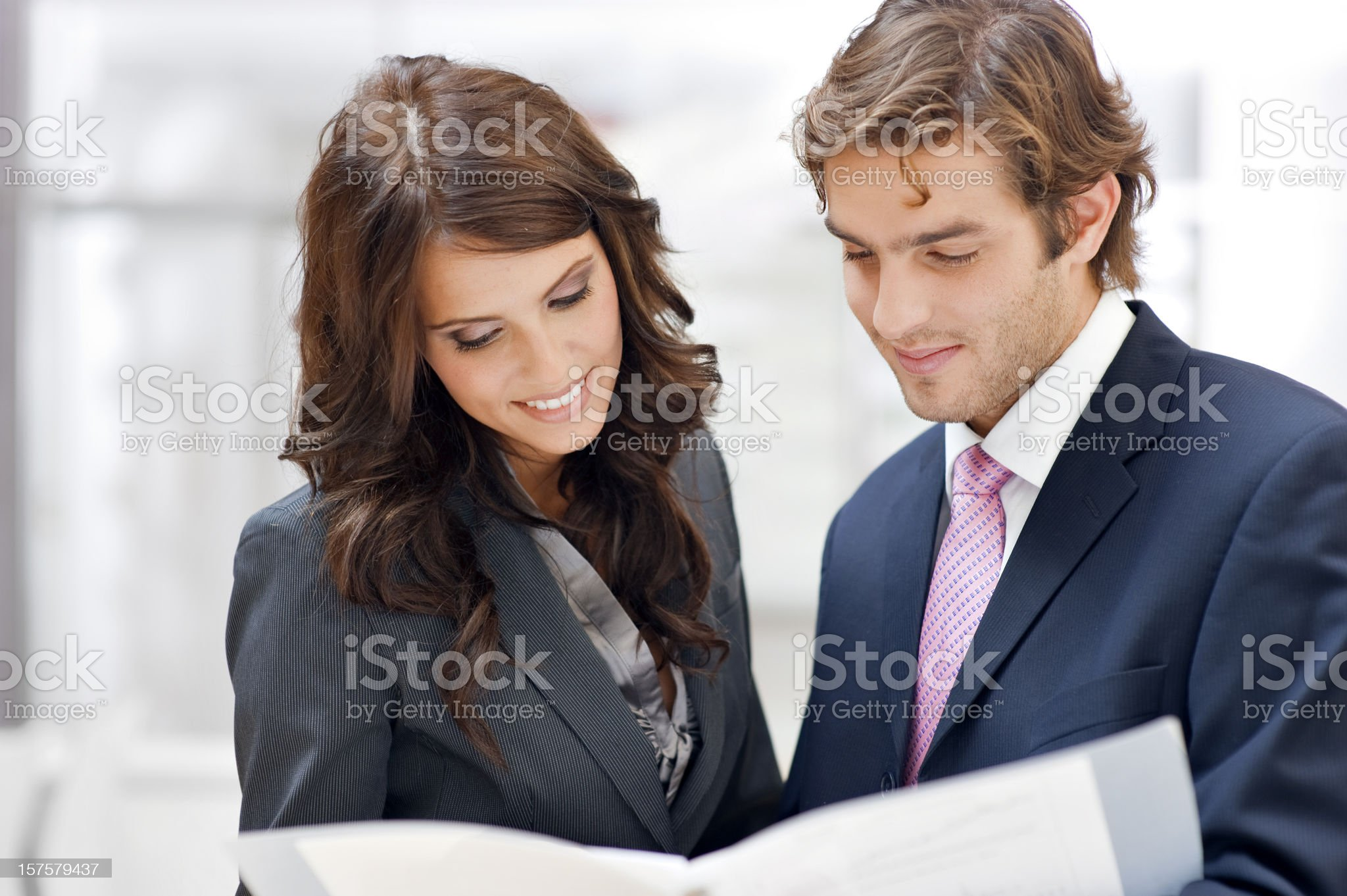 Two business people consulting royalty-free stock photo