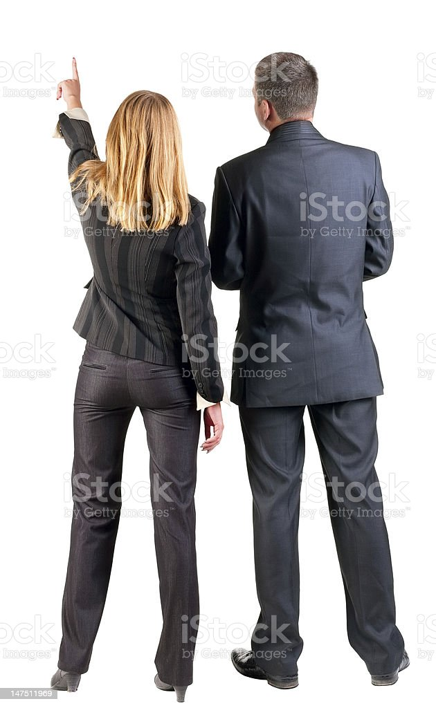 Two business people facing away while the woman points stock photo
