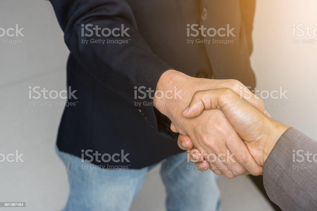 Two business people handshake. stock photo