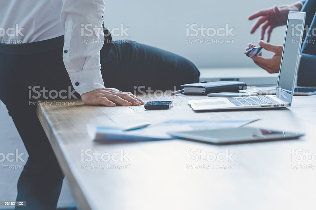 Two business people having a discussion. stock photo