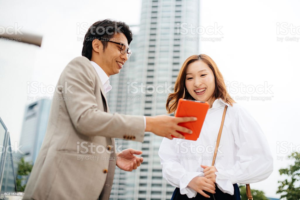 Two business people in Japan having brief eeting outdoors stock photo