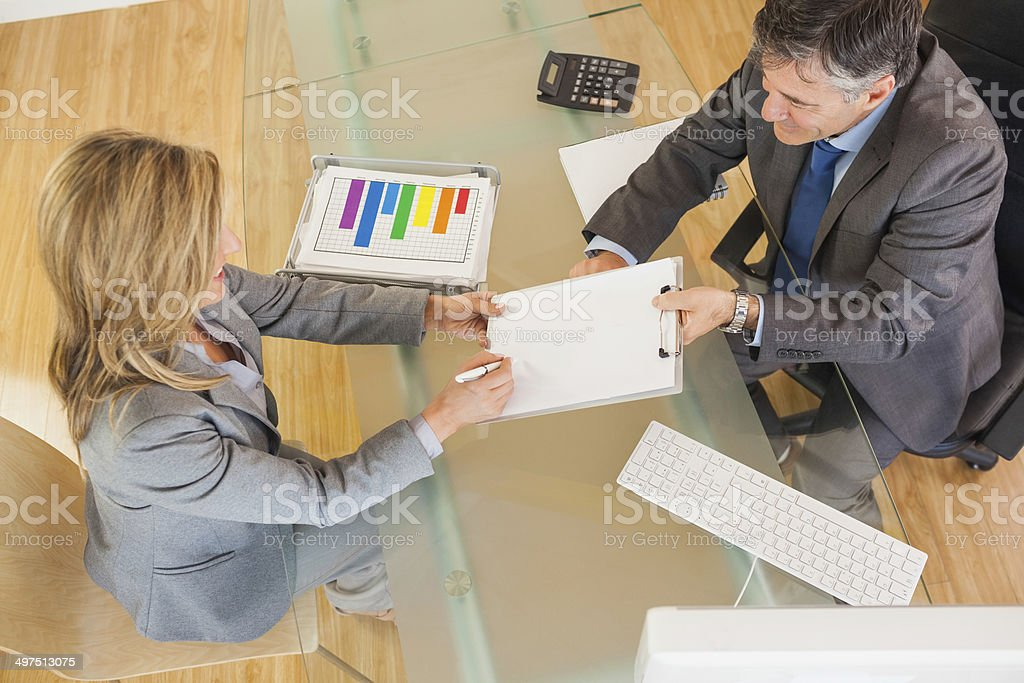 Two business people negociating in an office stock photo