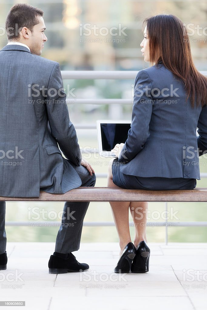 Two business people on a bench stock photo