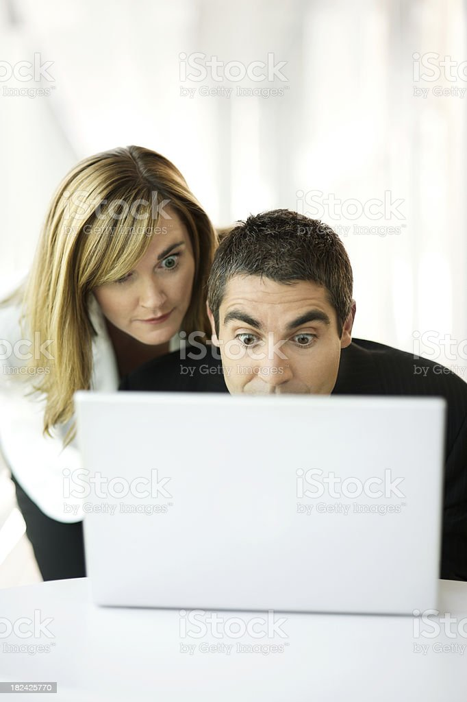 Two business people surprised with computer royalty-free stock photo