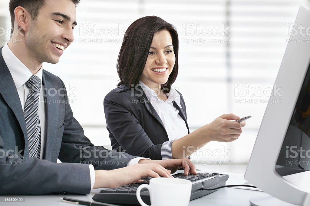 Two business people working in front of the computer stock photo