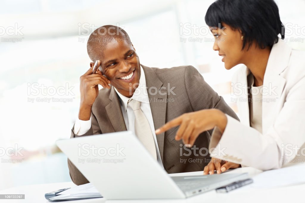 Two business people working on a laptop at office royalty-free stock photo