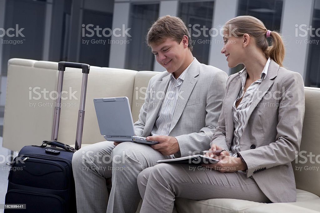 Two Business People Working on  Notebook in the Airport. royalty-free stock photo