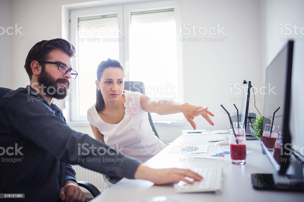 Two business people working on statistics stock photo