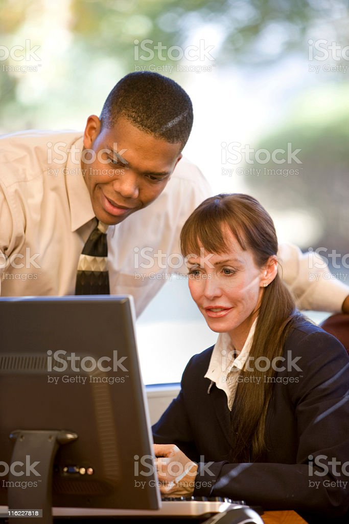 Two business people working together on a computer royalty-free stock photo