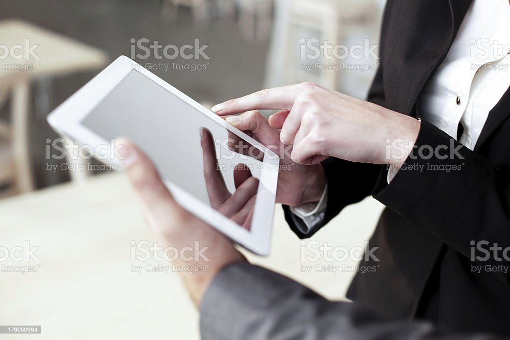 Two business people working with digital tablet royalty-free stock photo