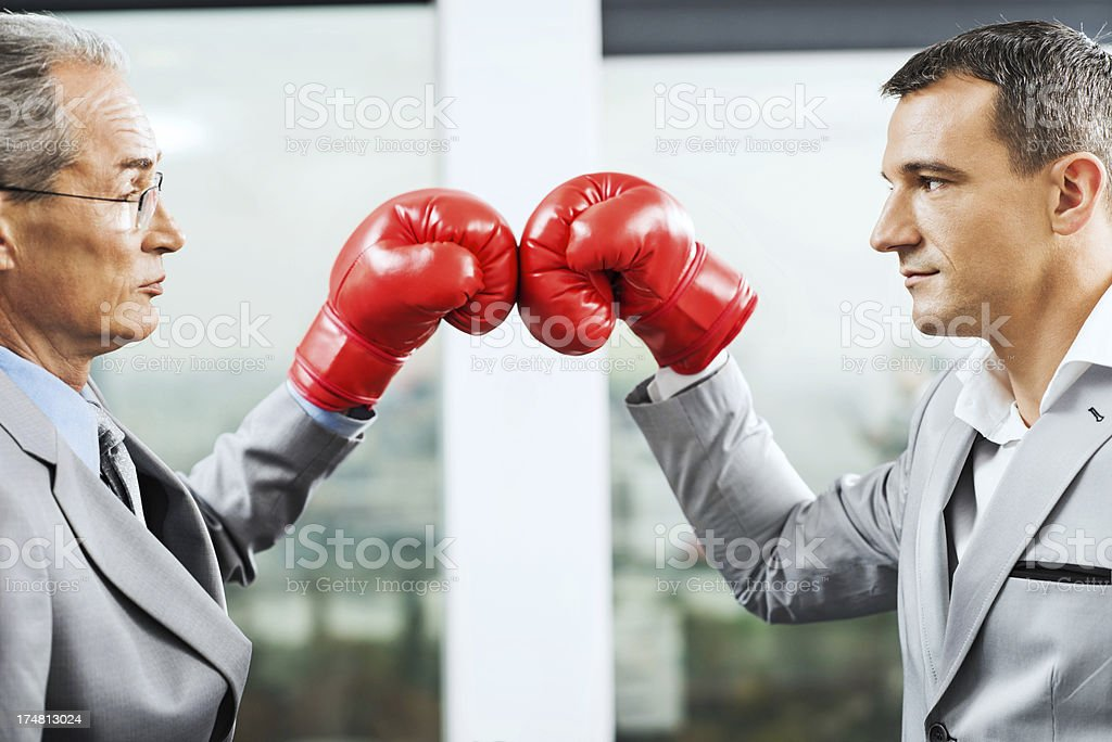 Two business rivals boxing. stock photo