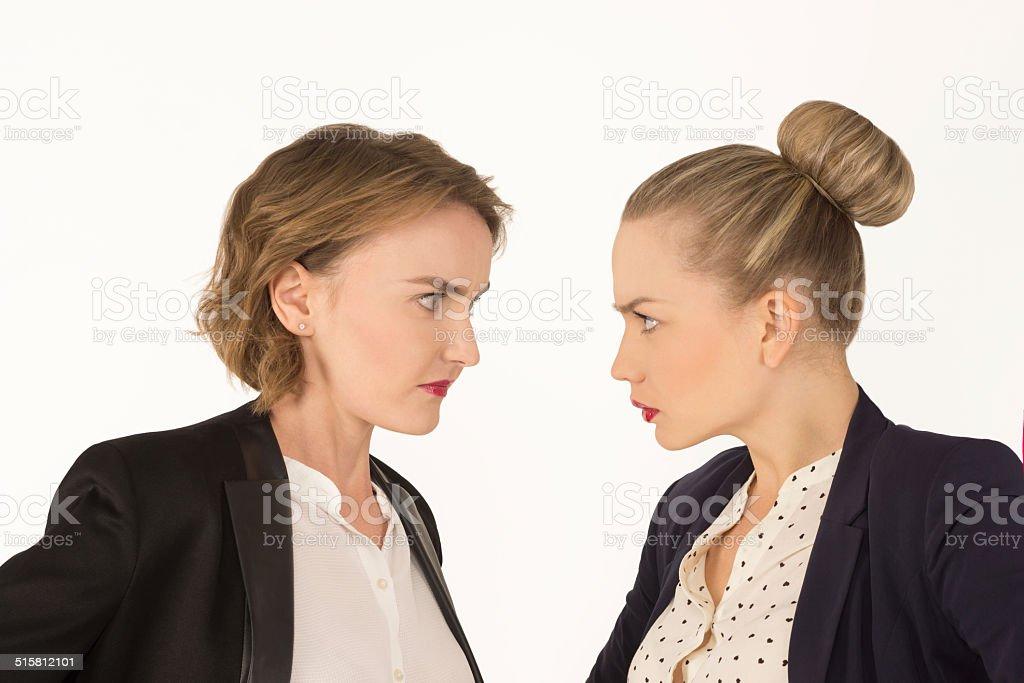 two business women swear stock photo