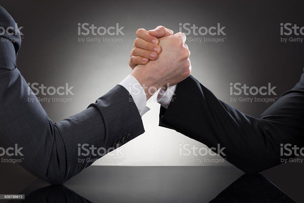 Two Businessman Arm Wrestling stock photo