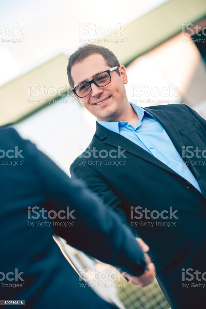 Two Businessman Colleagues Handshake with Smiling face stock photo