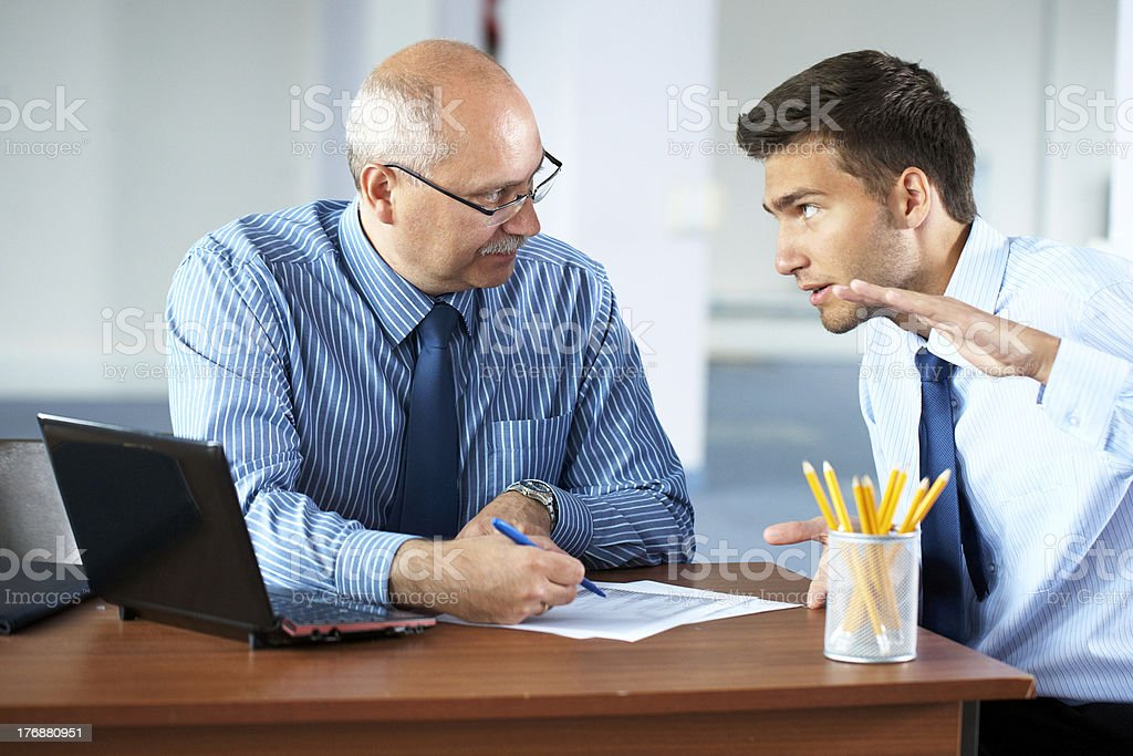 two businessman discuss something, office background royalty-free stock photo