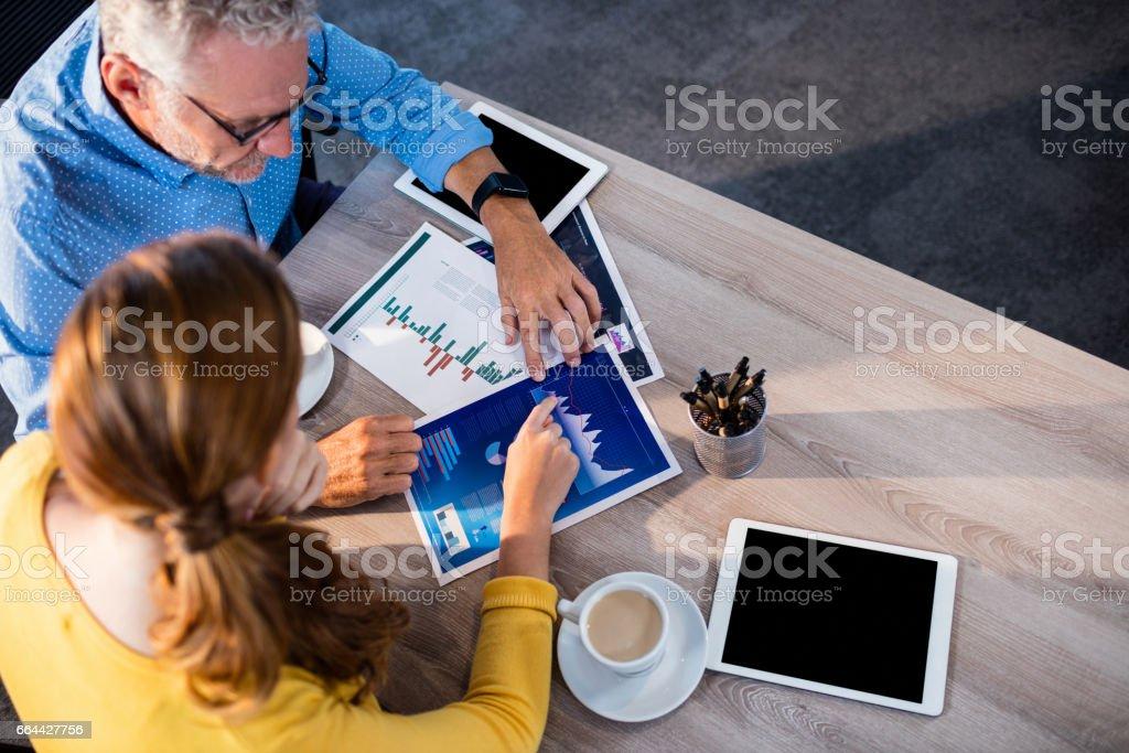 Two businessmen analyzing documents stock photo