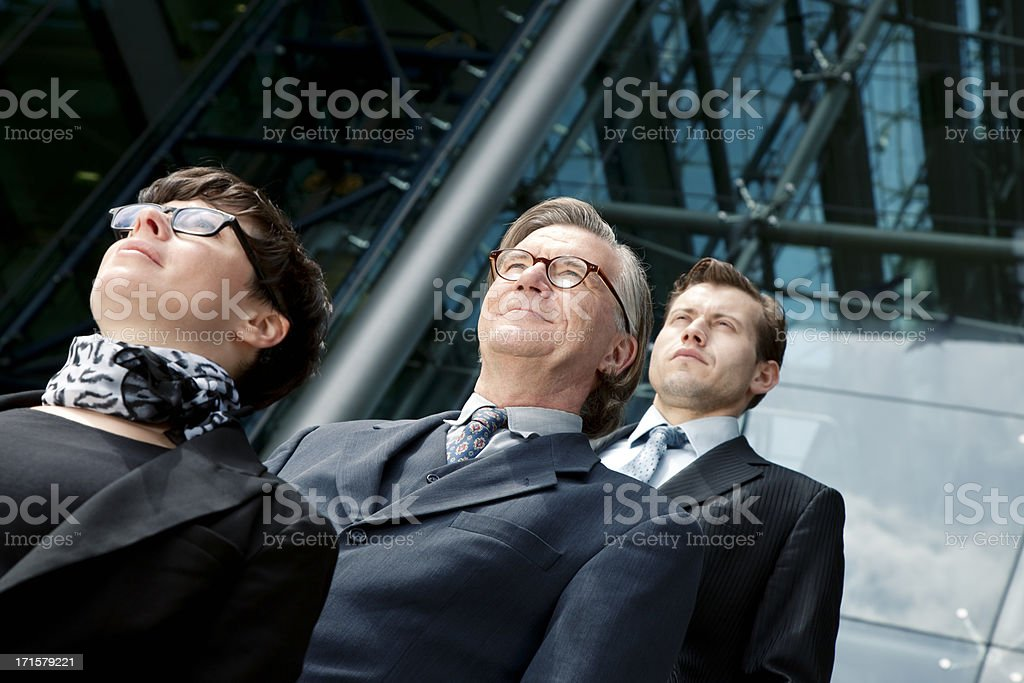 Two Businessmen and One Businesswoman Outside Office Building royalty-free stock photo