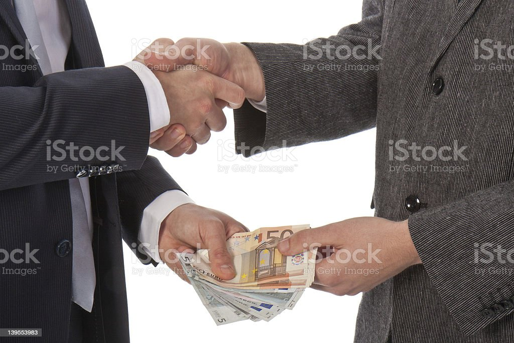 Two businessmen and paying money stock photo