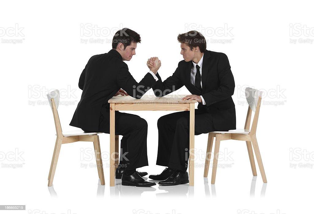 Two businessmen arm wrestling stock photo