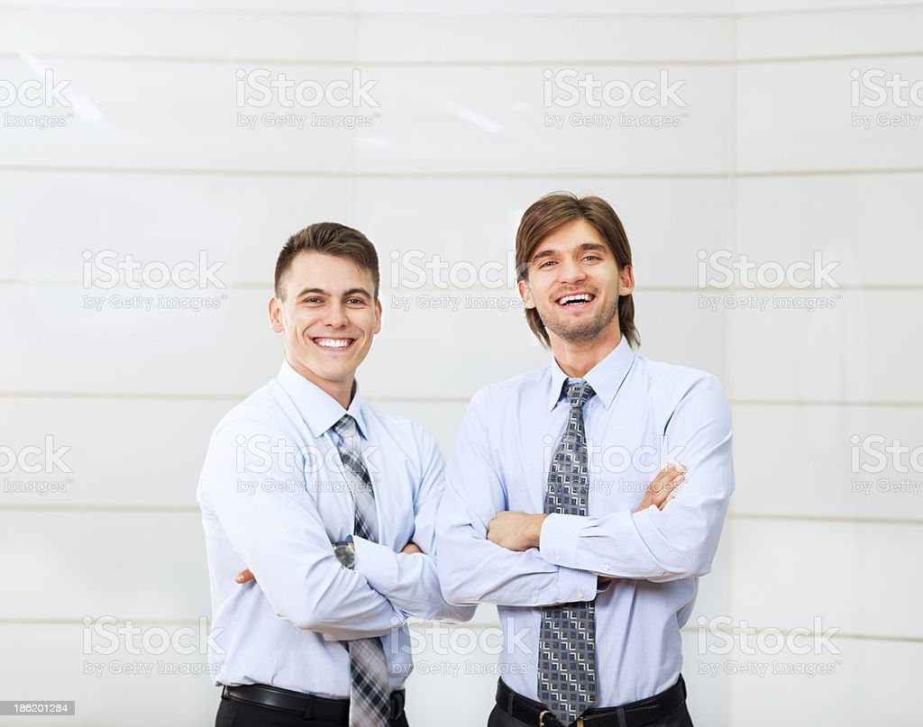 two businessmen coworkers smile at office royalty-free stock photo