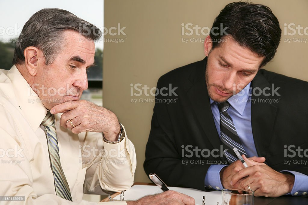Two Businessmen Discussing Business Documents royalty-free stock photo