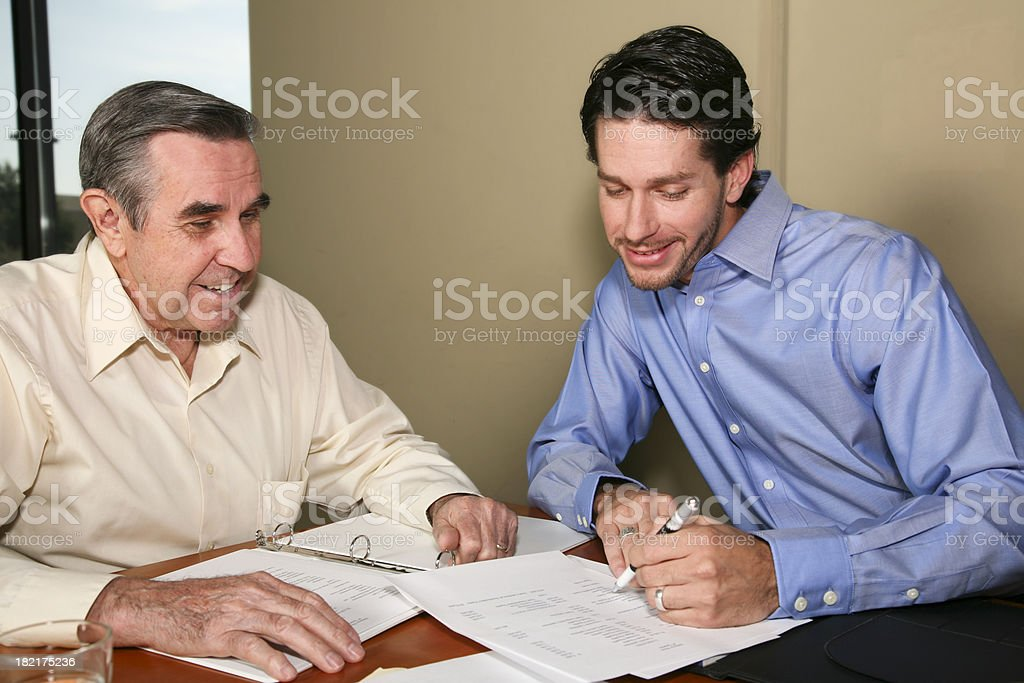 Two Businessmen discussing company financials royalty-free stock photo