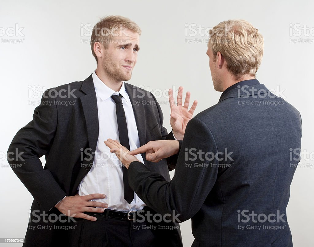 two businessmen discussing stock photo