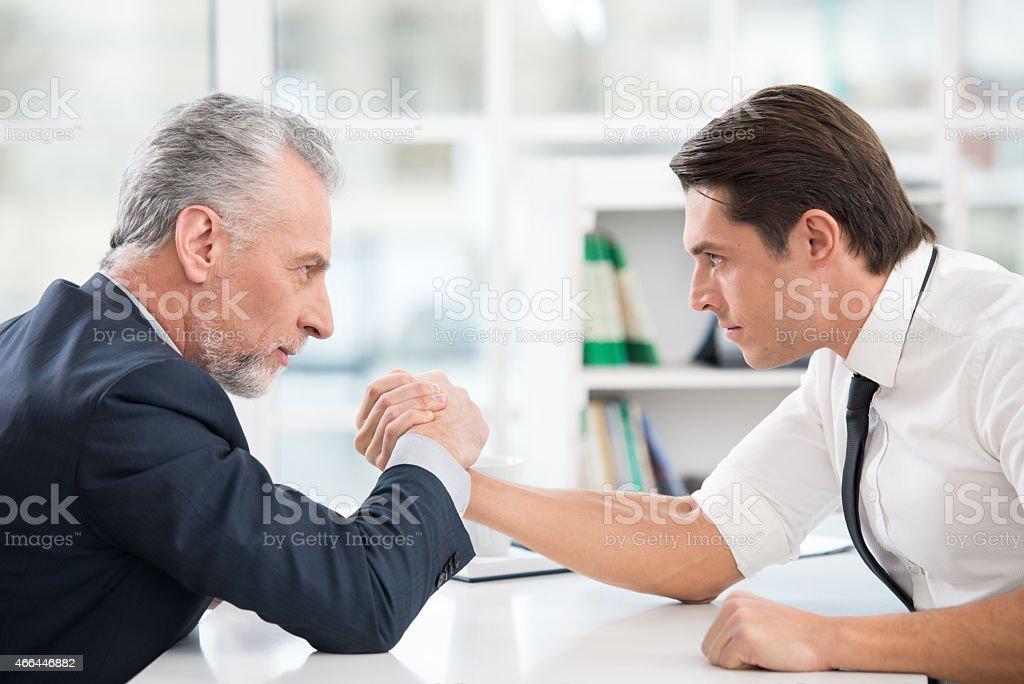 Two businessmen doing arm wrestling stock photo