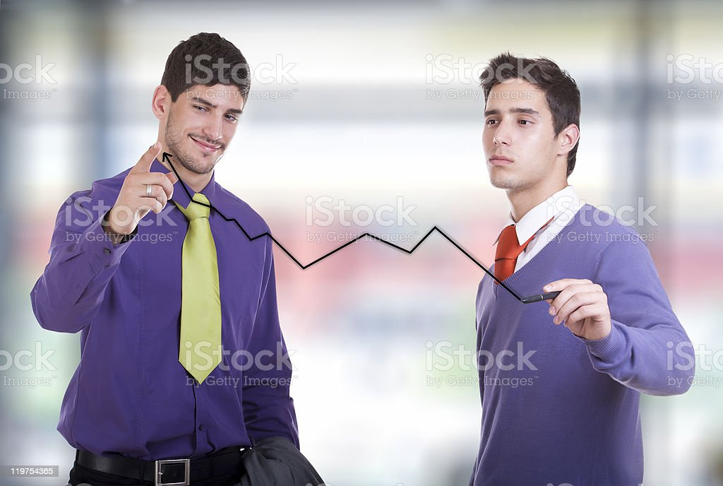 Two businessmen drawing a graph royalty-free stock photo