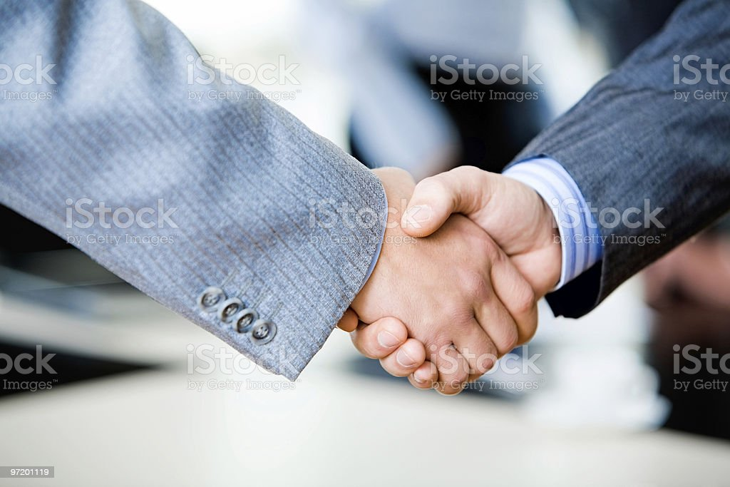 Two businessmen engaging in a handshake stock photo